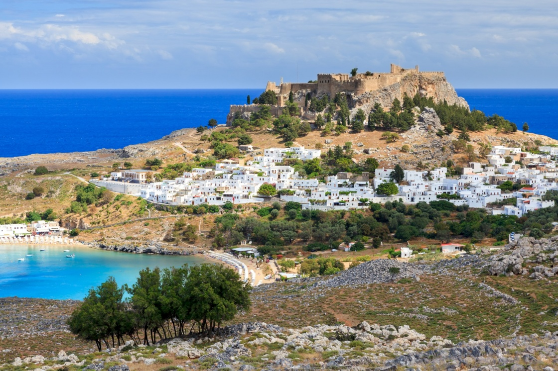 'View from the road down to the popular town of Lindos on the Island of Rhodes Greece' - Rhodos